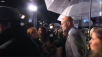 Mark Strong talking to fans under the rain...