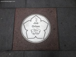 Joe Orton's plaque on street near Curve