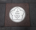 Joe Orton plaque on street near Curve