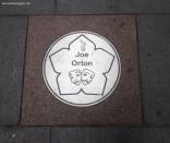 Joe Orton plaque on street near Curve
